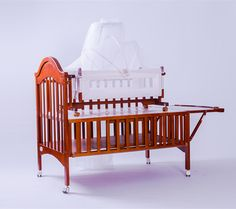 Hope Child Baby Crib >Cherry paint for full canopy >Front rial can be opened >Could be lengthened > With luxry cradle > Mosquito net and Bicolor mute wheels > Preventablegnawing rubber strip > Big store room