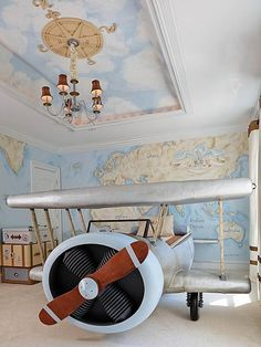 Encourage kids to explore the world around them with a map mural and airplane bed! Reminds me of Amelia Earhart.