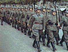 World War II Pictures In Details: A column of German Wehrmacht paraded in Paris #war #photography
