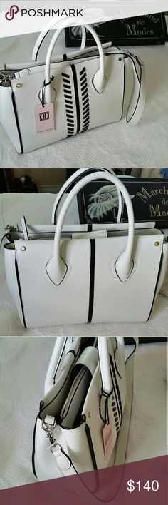 New Ivanka Trump White Leather Purse Class & style is how you describe this gorgeous and versatile bag. Includes a shoulder strap. Make it yours! Ivanka Trump Bags Shoulder Bags