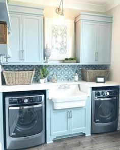 Laundry Room With Sink. Laundry Room Sink. Laundry Room Features Blue Gray  Cabinets And A Farmhouse Sink Flanked By A Pair Of Gray Washer And Dryer.