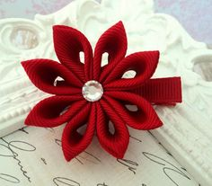 Hey, I found this really awesome Etsy listing at http://www.etsy.com/listing/72381698/red-kanzashi-flower-hair-clip