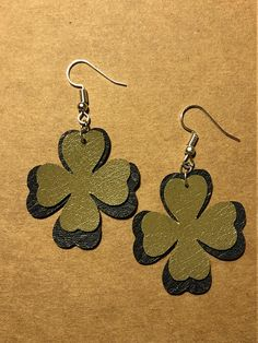 Shamrock leather earrings. A green leather shamrock on top of a grey leather shamrock. All rings and hooks are nickel free. A good pair of earrings to wear on St Patricks Day so that you feel Irish for a day. #1125