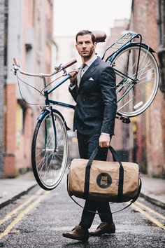 oh...uhhh....hello, beautiful man in suit with a bike and a sexy man bag. You are all things that are good.