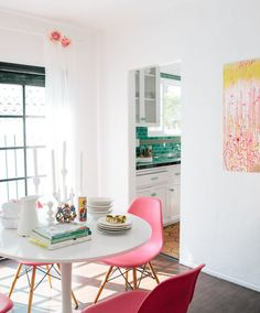 white tulip table and pink eames chairs