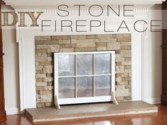 The link is to a DIY fireplace makeover, but I like the use of the old window as a fire screen. Clever!