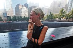 Carrie Bergonia by the name of her fiancé, firefighter Joseph Ogren, at the 9/11 memorial on the 12th anniversary of the attacks.