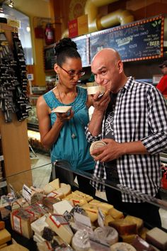 Carla and Michael choosing cheese at Murray's Cheese Shop in New York.