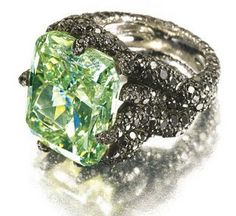 Green Diamond and Black Diamonds ring by de Grisogono. Pure green diamonds are extremely rare and extremely expensive, because the vegetation is usually present only in some parts of the diamonds.