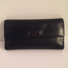 Kate Spade checkbook wallet Exterior is flawless. No worn corners. Zipper moves smoothly and fabric is spotless. Last two pics show tiny punctures are. Feel free to ask questions. kate spade Bags Wallets