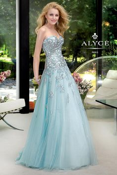 Look radiant for your next special event in this evening gown from Alyce Paris Prom 6029. This breathtaking tulle dress features sparkling sequin lace embroidery across the fitted bodice and trail onto the flowing, full-length skirt. The strapless sweetheart neckline is classic and will flatter your gorgeous figure for the big night. http://www.trendycollection.com/alyce-paris-prom-item-23172&category_id=0