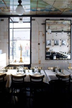Bold, gold grout used to fill in broken tile in this Parisian restaurant. Domino magazine.