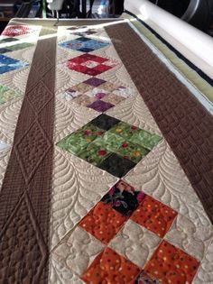 Note the curved line is most likely done with a ruler and does not right into the corner, leaving room for quilting the feathers.