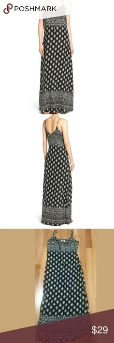 MIMI CHICA PRINT TIE FRONT MAXI DRESS SZ M VERY GOOD CONDITION. TAKES A SOPHISTICATED TURN WITH A MONOCHROME WOVEN MAXI DRESS THAT GAS A DELICATE DRAWSTRING CINCHED SCOOPED NECKLINE. 46 1/2 CENTER FRONT LENGTH  (SIZE MEDIUM ) FRONT DRAWSTRING TIE . ADJUSTABLE STRAPS. SCOOPED NECK. SLEEVELESS. 100% RAYON, ??9. BLACK /WHITE Mimi Chica Dresses Maxi