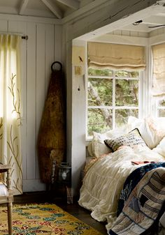Love this look for a small home. Beautiful quilts and soft furnishings US log cabin styles via Nan Lawson's Little Home blog.