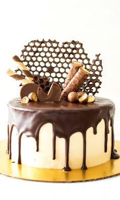 3 layers of dark chocolate cake     Reese peanut butter chocolate ganache…