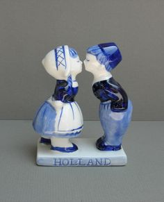 Vintage Delft Figurine Dutch Boy and Girl Kissing // My grandmother gave this to me as a child and it was always one of my favorite little nicknacks. Of all things to run into on Pinterest! - ME