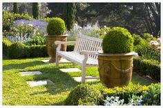estate gardens landscape architecture landscape design woodend garden bench with potted Boxwood and perennials formal garden.jpg