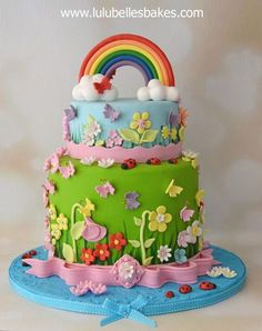 """this is probably one of the """"happiest"""" cakes I've made with so much going on – 6 layered rainbow sponge, lots of flowers and butterflies, families of ladybirds, and of course, the rainbow. Inspiration of this cake is from the lovely The Cupcake..."""