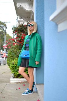 Emerald Green and Bright Blue outfit, how to wear bright blue, blue suede bag, fashion tips, styling tips, fashion ideas, capsule wardrobe, how to wear color, 'collecting' colors, how to wear blue and green, street style, blogger style, leather pleated skirt, j.crew stadium cloth coat, blue and green sneakers