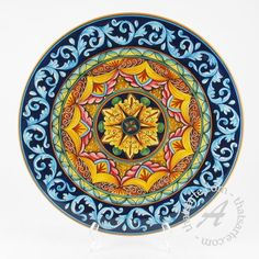 In this fine wall plate the designs of traditional Italian ceramics are uniquely blended with more contemporary patterns in bold colors. D&G are two young artists with a great creative talent and an excellent experience on traditional Ita Hand Painted Ceramics, Porcelain Ceramics, Ceramic Vase, Ceramic Pottery, Pottery Art, Pottery Painting, Ceramic Painting, Art Nouveau Tiles, Italian Pottery