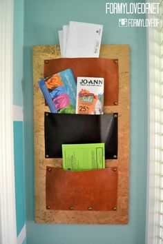 using a DIY leather pocket hanging organizer for mail sorting using scrap plywood and leftover leather fabric get organized for 2015