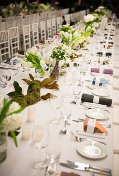 Long banquet table with white and green centerpieces at Australia's Museum of Contemporary Art, photos by Studio Impressions   via junebugweddings.com