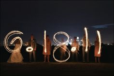 wedding date with sparklers - wedding party photo