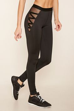 A pair of stretch-knit leggings with moisture management, mesh-paneled sides with crisscross detailing, and an elasticized waist.