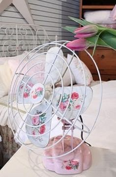 Vintage Fan with a dress up... a little paint and some decals.  Very cute.