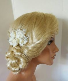 Check out this item in my Etsy shop https://www.etsy.com/listing/291871499/bridal-hair-comb-wedding-comb-decorative