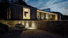 Modern house cantilevers over stone wall in England | Stone walls ...