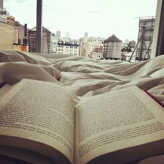 Books in bed.