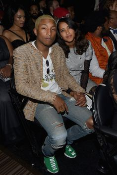 Pharrell Williams Photos - Recording artist Pharrell Williams (L) and Helen Lasichanh attend The 58th GRAMMY Awards at Staples Center on February 15, 2016 in Los Angeles, California. - The 58th GRAMMY Awards - Backstage and Audience