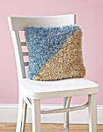 Two tone knitted pillow