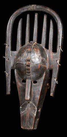 Africa | Mask from the Malinke culture of Mali | Wood, metal rings, natural fiber