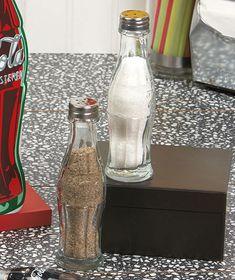"Coca-Cola Salt And Pepper Shakers Coca-Cola Salt and Pepper Shakers will give your kitchen a fun, retro look. These salt and pepper shakers feature the trademarked contour bottle design and ""Coca-Cola"" in the familiar font. Vintage Coca Cola, Coca Cola Ad, Always Coca Cola, Glass Coke Bottles, Coca Cola Bottles, Coke Bottle Crafts, Garrafa Coca Cola, Coca Cola Decor, Coca Cola Kitchen"