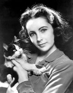 Elizabeth Taylor & kitty, 1946 even as a child she wasn't cute...she was beautiful and striking looking...and those unbelievable violet eyes