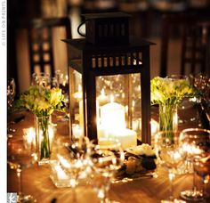 Lantern Centerpieces surrounded by candles and flowers