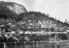 seen from across the Link River; first row of houses on Nevin Avenue, houses under construction on Fourth Street; Anglican church at centre; top row of houses is Street - RBCM Archives House Under Construction, Anglican Church, Central Coast, British Columbia, The Row, Ocean, River, Street, Fall