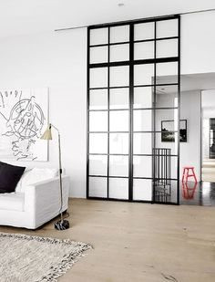 There's nothing as sleek as a glass partition. They're often used in office spaces, but totally appropriate for the home, too! Check out these glass partitions perfect for dividing a room in your home. For more interior ideas, go to Domino.