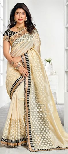194587 Beige and Brown color family Bollywood sarees in Banarasi,Silk fabric with Border work .
