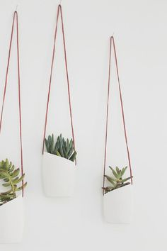 Hanging Planters You Can Make YourselfUpcycled Planters by Almost Makes Perfect You'll never guess what these beautifully minimal planters are made out of! Spoiler alert: lotion bottles.