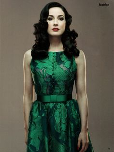 Dita Von Teese in a green dress which makes pale skin look so mysteriously beautiful