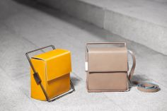 Structurae Collection. Leather handbags. Handmade in Spain. I Got Rhythm model in two colors: Grey and yellow mustard.
