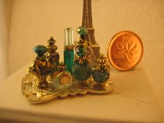 Several examples (not tutorials) of vanity table trays with assorted perfumes etc. | Source: Studio E