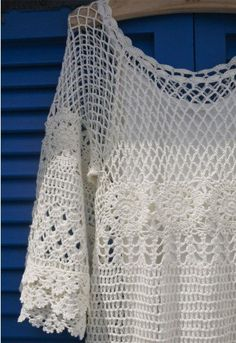 Fancy at sexy fishnet design but still want to look elegant?This pure white fishnet crochet dress is the one you are looking for!Featuring delicate fishnet and sunflower crochet patterns, and multi-tier frills at the sleeves, with a white bottom dress attached, this hand knit crochet dress can meet your perfectionist requirements from every angle. Simply pair it with a pendant necklace, and a pair of summer style wedges or high heels. It would be one of your best dating outfits. -100%…