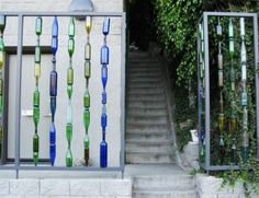 Recycled Glass Bottles made into a fence or maybe a room divider, etc.