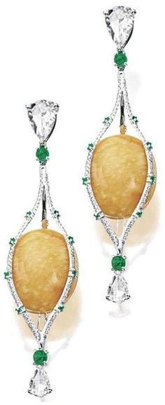 MELO PEARL, DIAMOND AND EMERALD PENDENT EARRINGS.     Each suspending on an oval melo pearl, embraced by an oblong marquise-shaped frame set with brilliant-cut diamonds highlighted by circular-cut emeralds, surmounted and anchored by a pear-shaped rose-cut diamond linked by a cabochon emerald, the diamonds weighing approximately 2.80 carats, mounted in 18 karat white gold. Sotheby's.