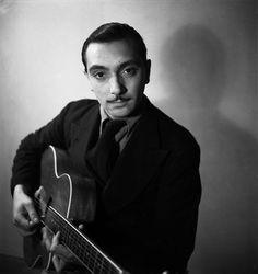 Django Reinhardt (1910-1953) - Belgian guitarist and composer of Romani heritage. Photo by Emile Savitry, 1933